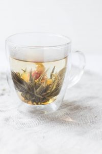 Flower tea or Blooming tea are a flower with tea leaves that are dried